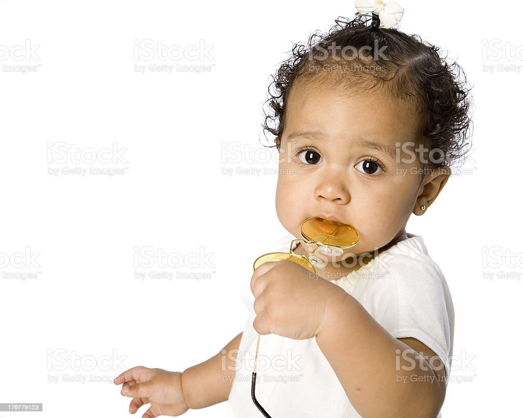 Mixed Race Baby Teething and Chewing on Toy stock photo