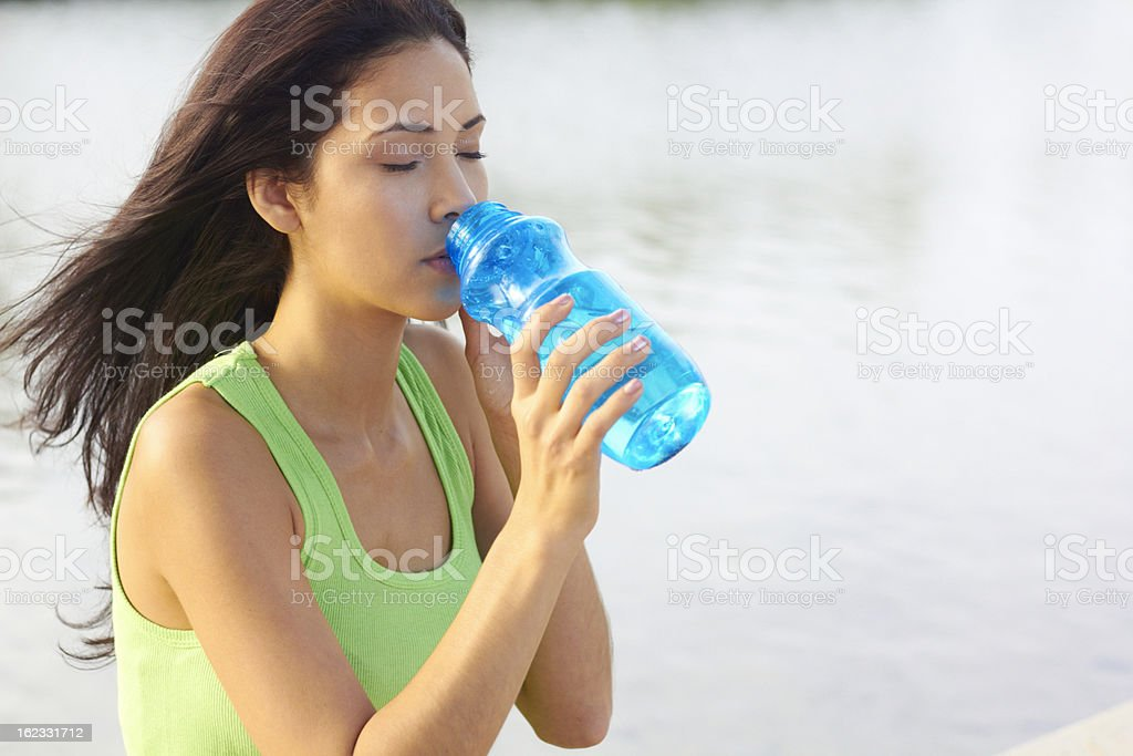 Mixed Race Beautiful Young Sporty Woman Drinking Water royalty-free stock photo