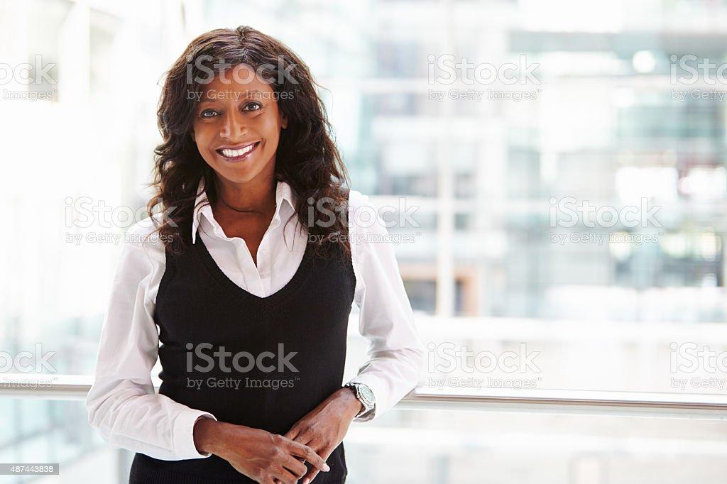 Mixed race businesswoman, waist up portrait stock photo