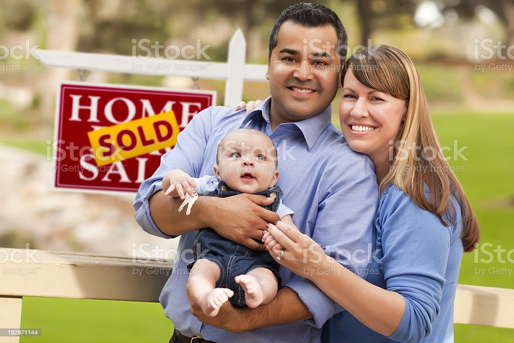 Mixed Race Couple, Baby, Sold Real Estate Sign royalty-free stock photo