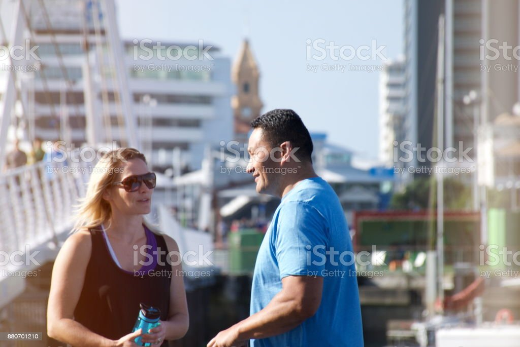 Mixed Race Couple in Sports Clothing in Urban Scene stock photo