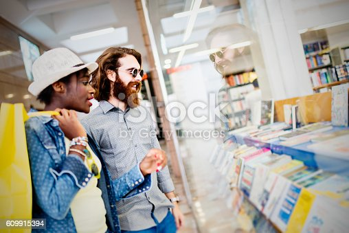 istock Mixed race couple looking at shop window 609915394
