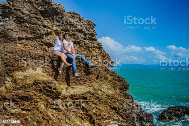 Mixed race couple thai man and european woman at a cliff watching picture id675213646?b=1&k=6&m=675213646&s=612x612&h=htramsbc5dhaehndeync2aetcijvp8ztwsniasre8km=
