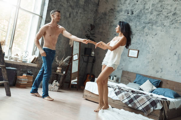 Mixed race couple young man and woman in bedroom dancing active picture id1199330449?b=1&k=6&m=1199330449&s=612x612&w=0&h=rlvjuiruoz j2e9so05qxjbhb6yg0iqguwoxxt5 epk=