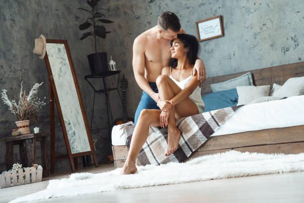 Mixed race couple young man hugging and kissing woman at home sitting picture id1200143409?b=1&k=6&m=1200143409&s=612x612&w=0&h=ugnsu7x 0bsumwx3brrgg4qupq d08kjj2lqnai0yq8=