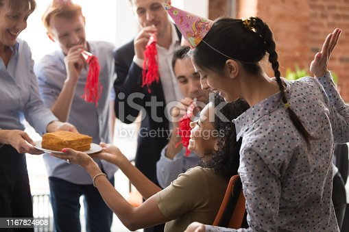 istock Mixed race employee receiving congratulation happy birthday from diverse colleagues 1167824908