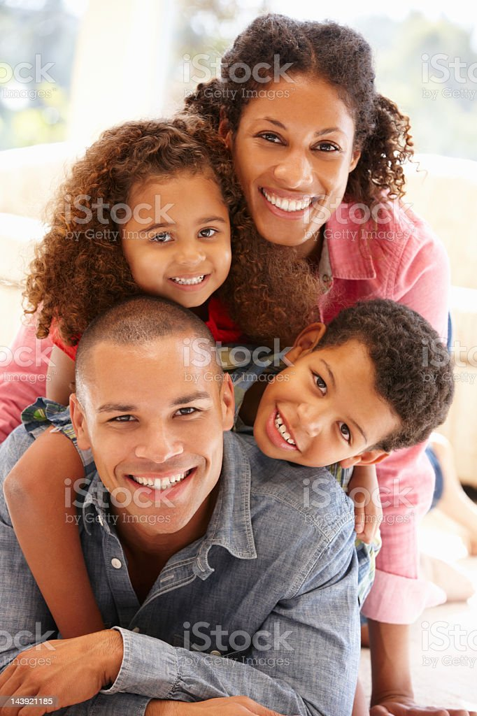 Mixed race family at home royalty-free stock photo