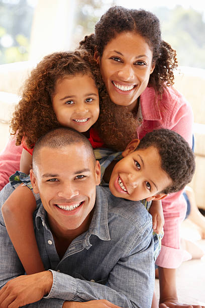 Mixed race family at home stock photo