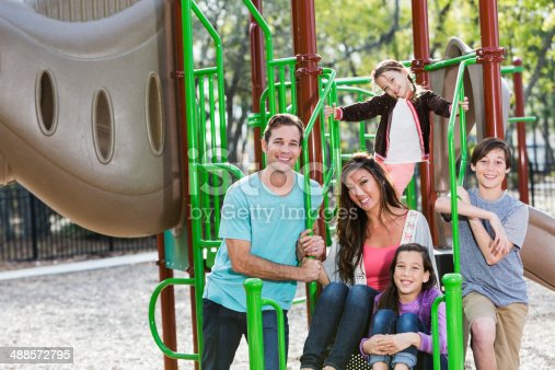 istock Mixed race family at park 488572795