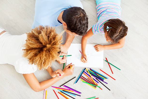 mixed race family coloring and drawing. - colouring book stock photos and pictures