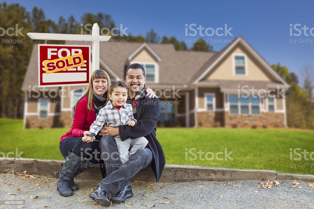 Mixed Race Family, Home, Sold For Sale Real Estate Sign stock photo
