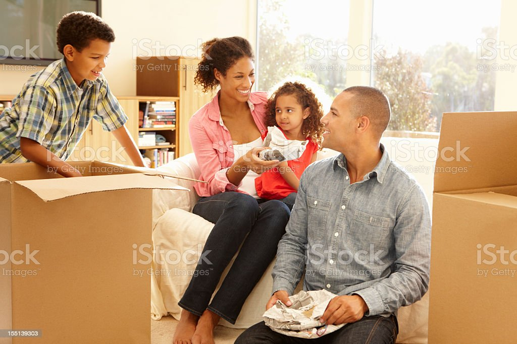 Mixed race family in new home stock photo