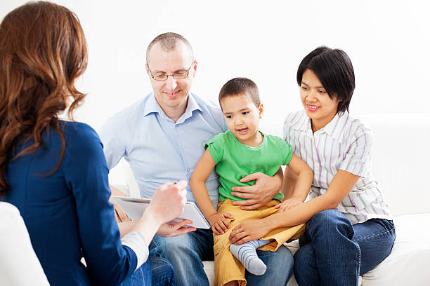 mixed race family meeting with financial advisor - four lawyers stockfoto's en -beelden