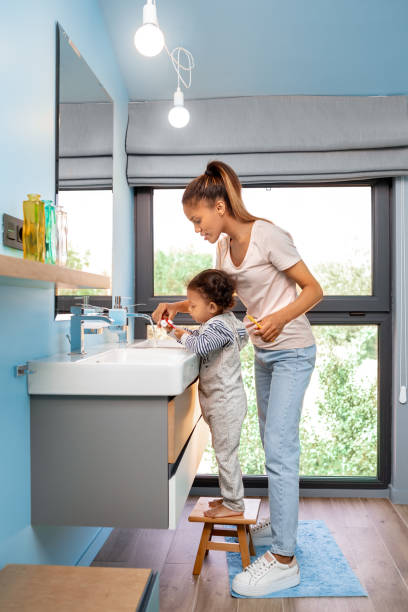 Mixed race family mother helping little daughter to brush teeth at picture id1193200105?b=1&k=6&m=1193200105&s=612x612&w=0&h= rdlf2zmoxkggk7g7xs1hkxgy0nzx0siqqnapdxdo44=