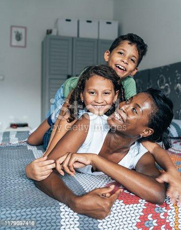 172407626istockphoto Mixed race family 1179697416