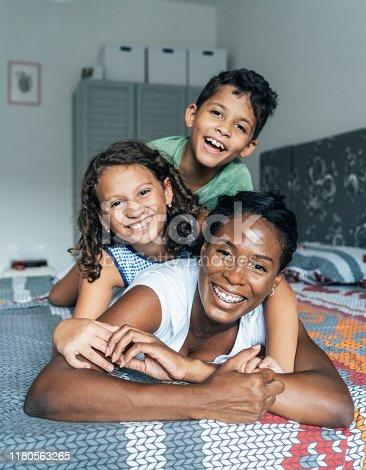 172407626istockphoto Mixed race family 1180563265