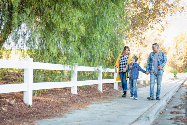 Mixed Race Family Taking A Walk Outdoors stock photo