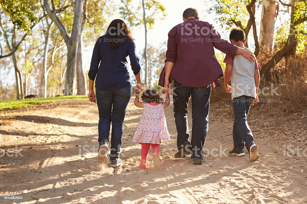 Mixed race family walking on rural path, close up stock photo