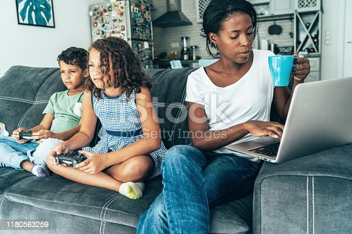 istock Mixed race family with digital devices 1180563259