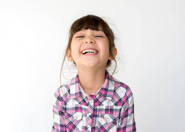 mixed race girl big smile head shot portrait - child stock photos and pictures