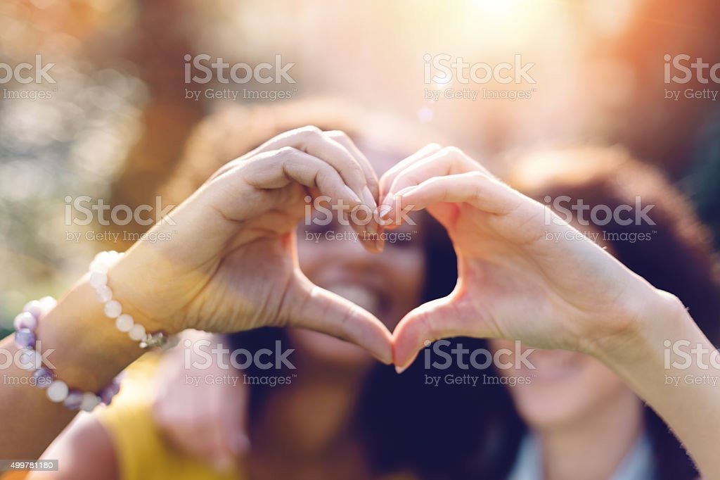 Mixed Race Girls Making Heart Symbol With Hands Stock Photo More
