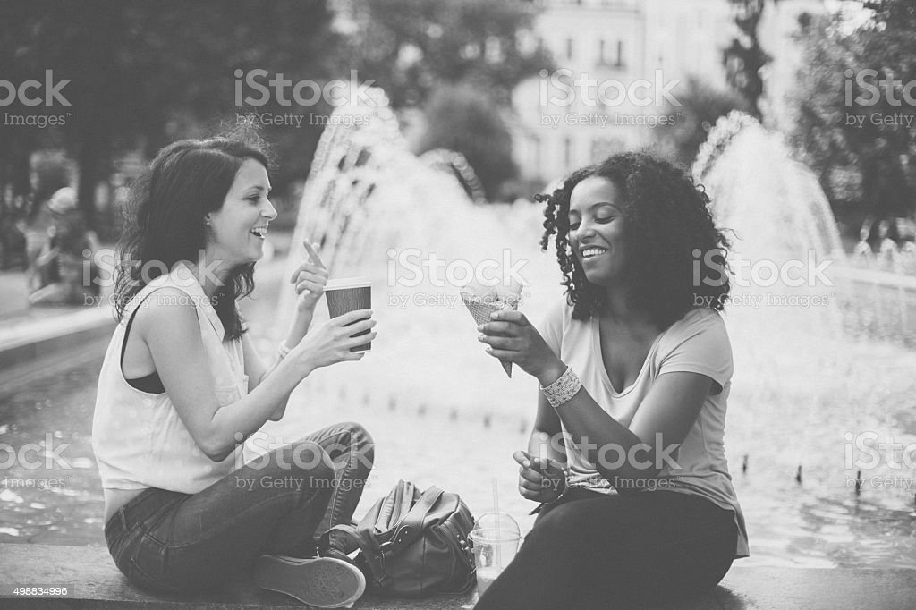 Mixed race girls talking and laughing in Sofia stock photo