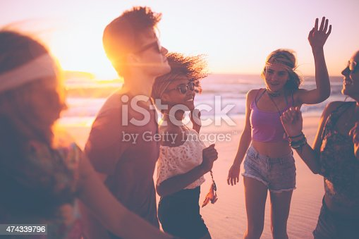 istock Mixed race group of friends dancing together at a beachparty 474339796