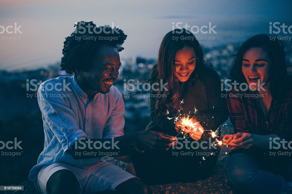 Mixed Race Group of young adults celebrating new years eve stock photo