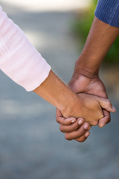 mixed race hands - carolinemaryan stock pictures, royalty-free photos & images