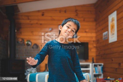 istock Mixed race kid in playful mood. 1010036488