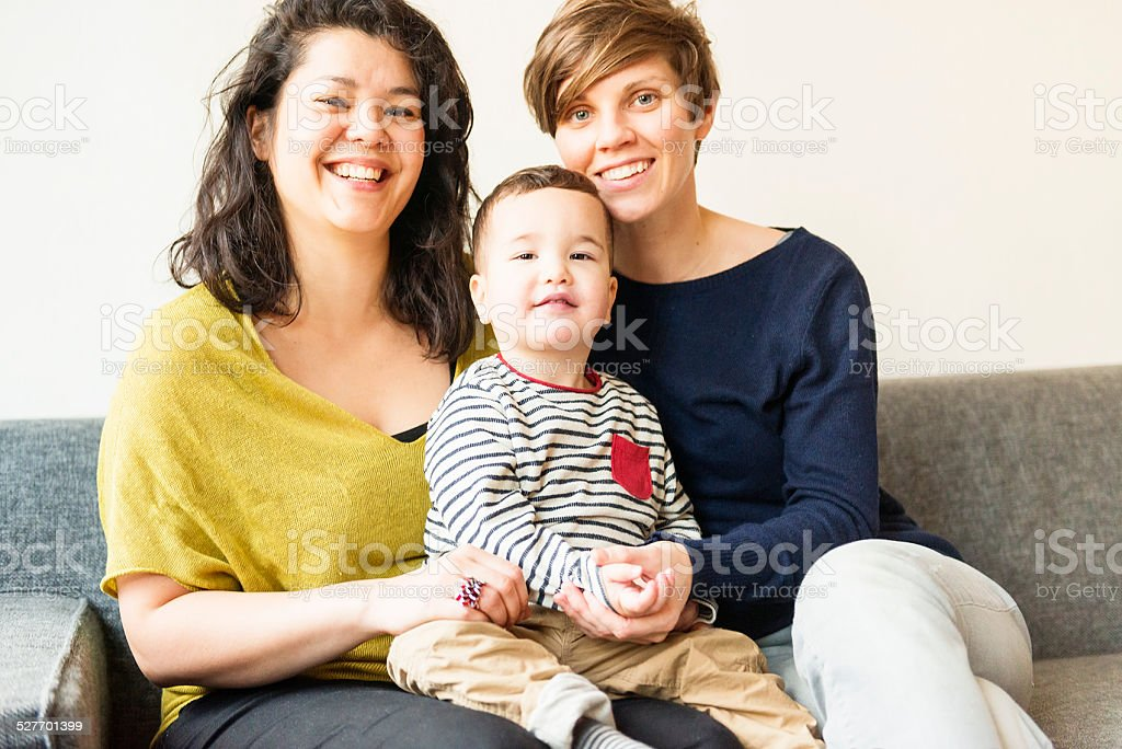 Mixed race lesbian family portrait stock photo
