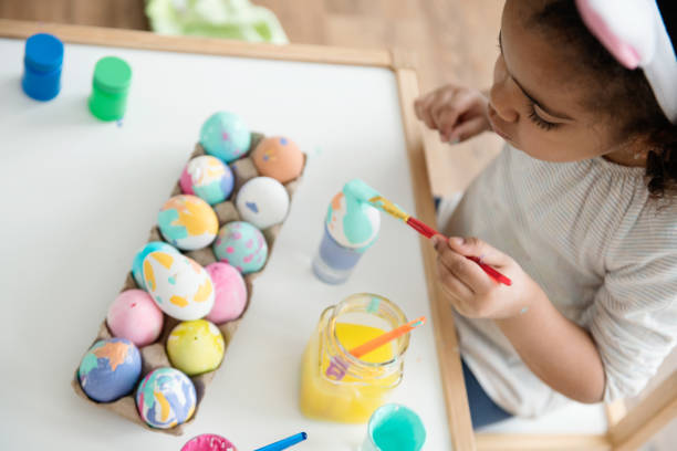 Mixed race little girl painting easter eggs picture id922165268?b=1&k=6&m=922165268&s=612x612&w=0&h=jyljlpqhphqkqyjemw17empgbqrkenx2ti clpaebb4=