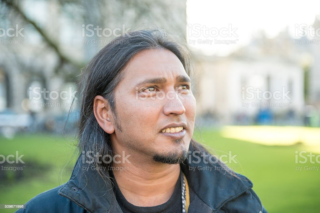 mixed race man looking to one side royalty-free stock photo