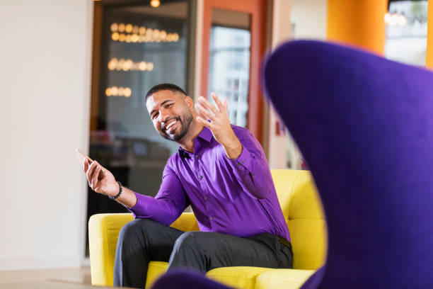 Mixed race man working in brightly colored office stock photo