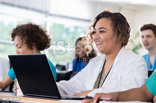 istock Mixed race medical student uses laptop in class 637181838