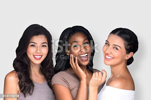 istock Mixed race multi-ethnic female friends laughing together perfect smile 614115218