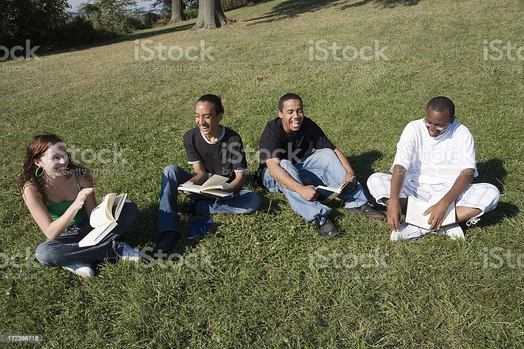 Mixed race students studying outdoor stock photo