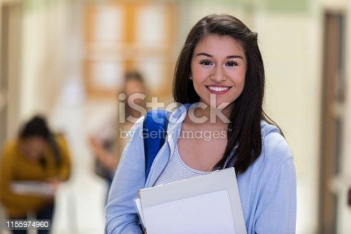 istock Mixed race teen smiles for photographer 1155974960
