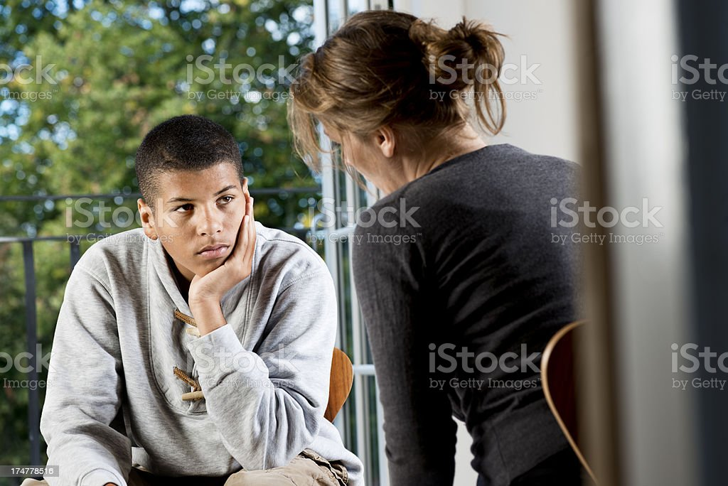 Mixed Race Teenager  Talking To Counsellor or Teacher stock photo
