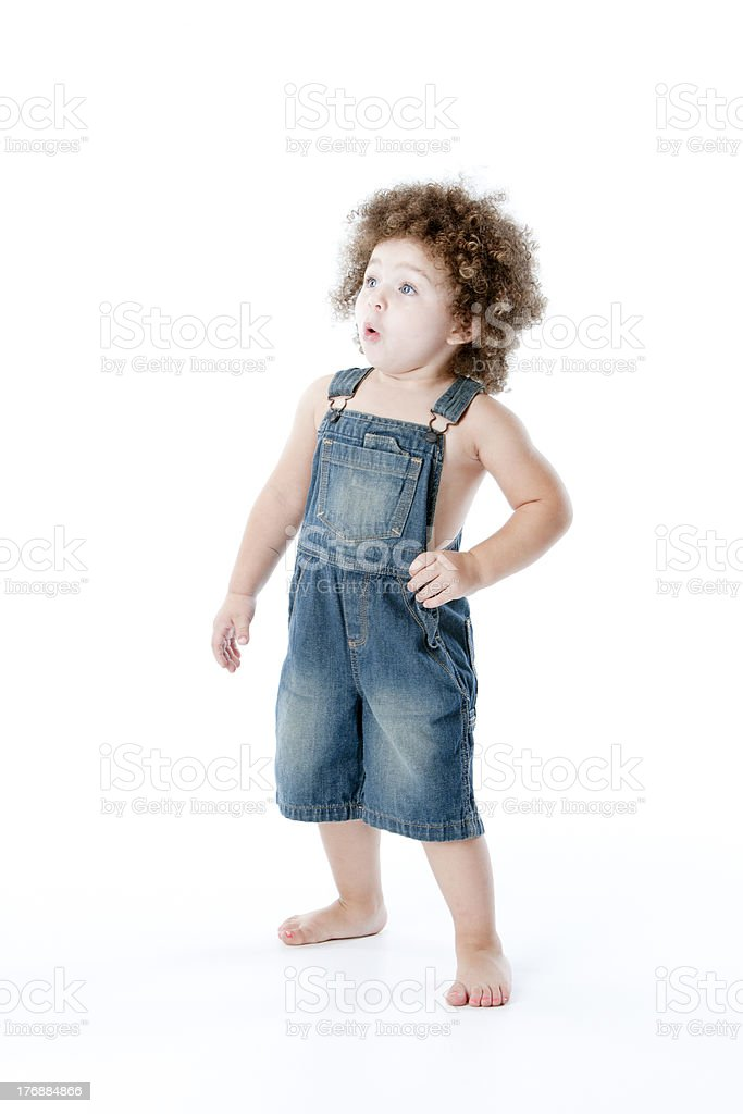 Mixed Race Toddler Girl Looks Up in Surprise stock photo