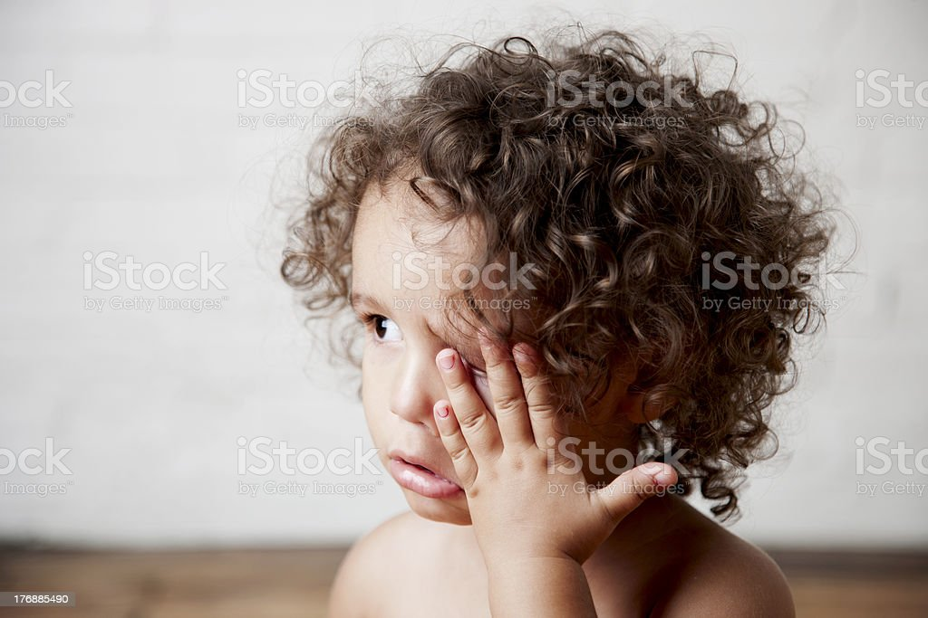 Mixed Race Toddler Girl Rubbing Her Eyes and Crying stock photo