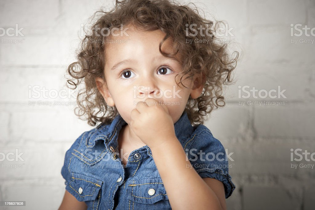 Mixed Race Toddler Girl with a Timid Expression stock photo