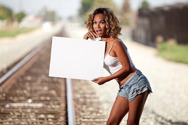 Mixed race Transgender female holding blank sign stock photo