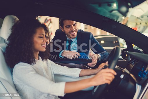 istock Mixed race woman enjoying new car 913442166
