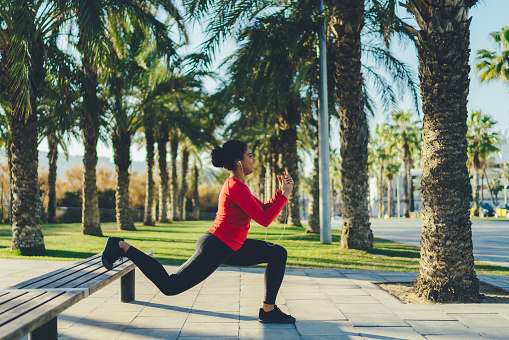 Woman working out in the city park
