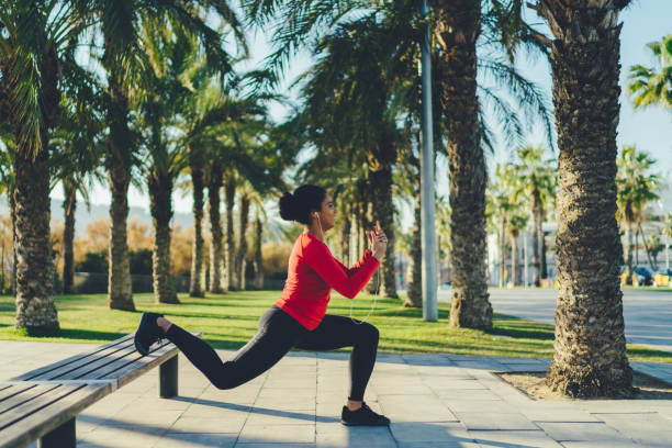 Mixed race woman in Barcelona exercising in the city stock photo