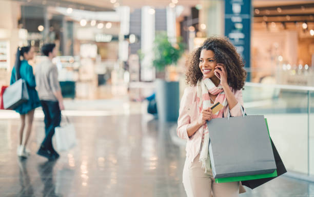 Mixed race woman in the shopping center stock photo