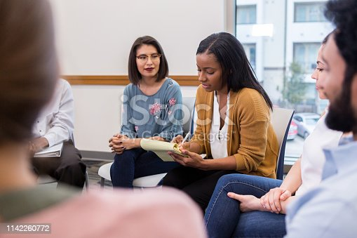 511741068 istock photo A mixed race woman leads coworkers 1142260772