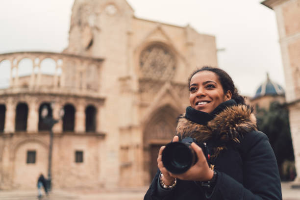 Mixed race woman traveling single in Europe,Plaza de la Virgen,Valencia stock photo