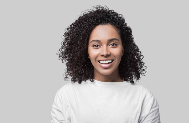 Mixed race woman wearing white t-shirt studio portrait stock photo